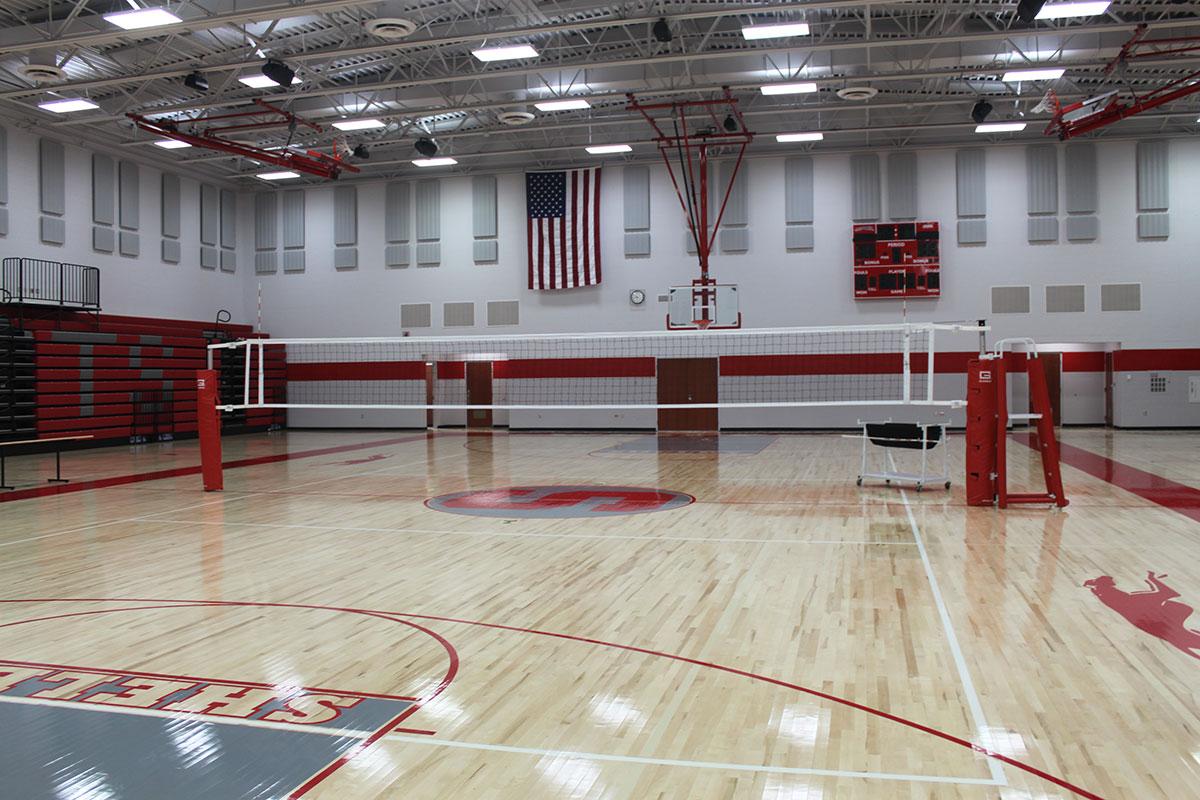Volleyball net over basketball court