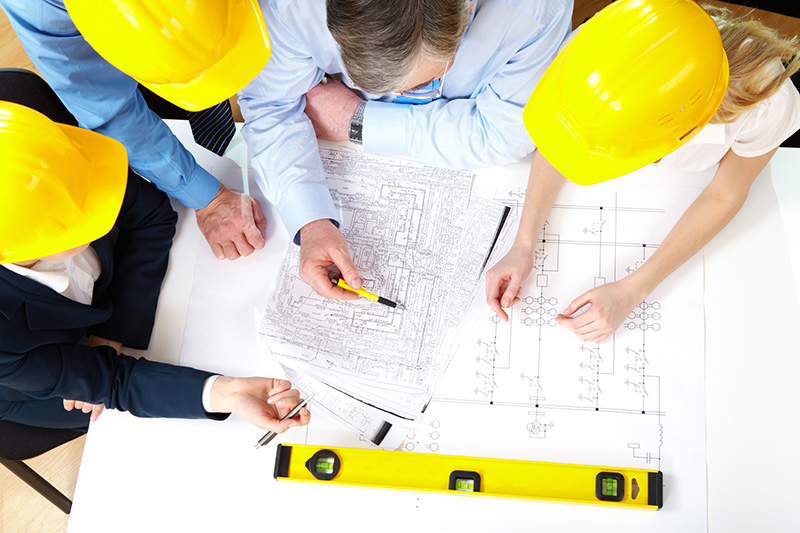 Group of contractors reviewing plans